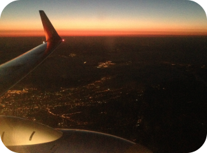 Sunset view from an airplane of a city